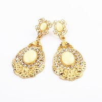 Golden Color Oval Shape Cut Out Design Earrings