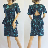 1980s Vintage Black and Turquoise Floral Print Peplum Open Back Dress by Milanzo