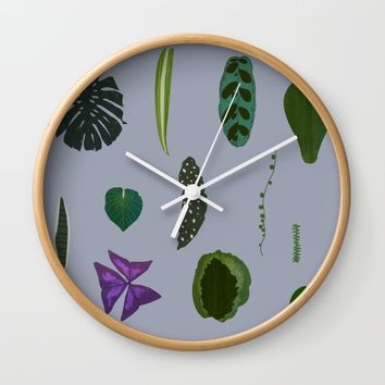 A non-scientific botanical investigation of the indoor plant.  Wall Clock by Olivia James