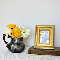 Tiny sheet music collage in gold frame.  Vintage inspired home, apartment, or dorm decor for small space decorating