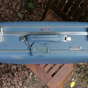 American Tourister Marine Blue 21 Inch Suitcase Blue Quilted Satin Lining