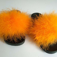 Orange faux fur slides