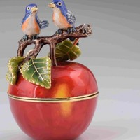 Love Birds sitting on Red Apple
