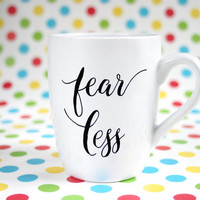 "Hand painted motivational mug with text ""Fearless"""