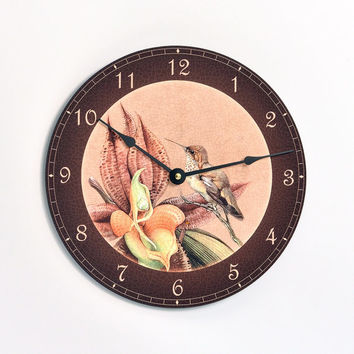 Vintage Victorian style bird and orchid 10 inch wall clock.  Antique tan background with orange flower. CL3017
