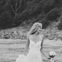 Stunning low back white lace wedding dress, dreamy floaty skirt and short lace front hem