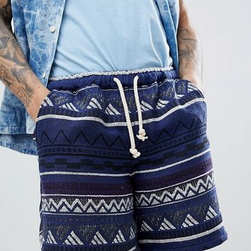 ASOS DESIGN Festival Slim Shorts In Navy Aztec Jacquard With Elasticated Waist at asos.com