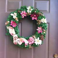 Christmas wreath evergreen with bright poinsettia and bows
