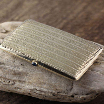 14k yellow Gold Cigarette Case with a Basel set Sapphire