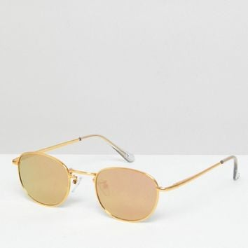 ASOS DESIGN 90S small oval sunglasses in rose gold flash lens at asos.com