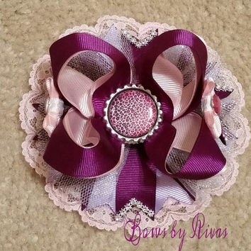 Purple, Light Pink, and Light Purple Boutique Stacked Hair Bow with Lace, Rhinestones, Tulle, and Purple Leopard Print Bottle Cap