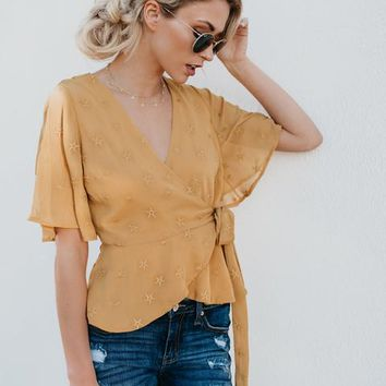 Gotta Give Embroidered Wrap Star Top