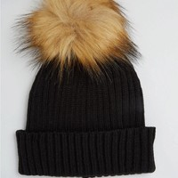ASOS | ASOS Rib Beanie With Oversized Ginger Faux Fur Pom at ASOS