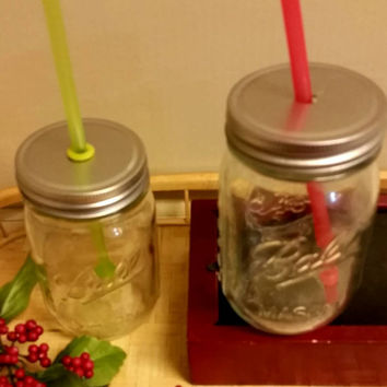 Set of two glass, pint size mason jar sippy cups. Holiday inspired with red a green straws. Perfect gift for on the go