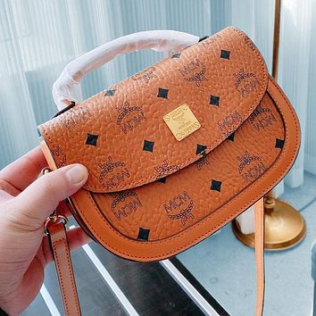 Mcm new saddle bag delivery puppy pendant three-piece delivery box Crossbody Bag Brown