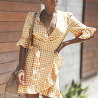 Women's orange and white checked v-neck, five-point sleeve wrap with flounce skirt