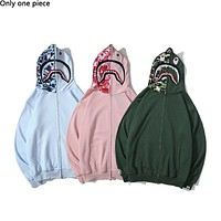 BAPE selling a new line of embroidered shark camouflage cap zip-up jackets