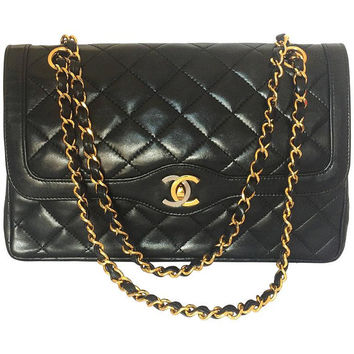 Vintage Chanel black 2.55 classic double flap bag with gold and silver CC motif and chains. Paris limited edition. Rare. Beautiful condition