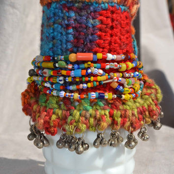 Wide Beaded Boho Cuff Bracelet With Charms on Crochet Cotton Background and African Trade Beads