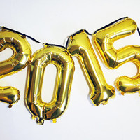 2015 gold mylar balloon banner for new years eve on black ribbon. A NYE wow piece.