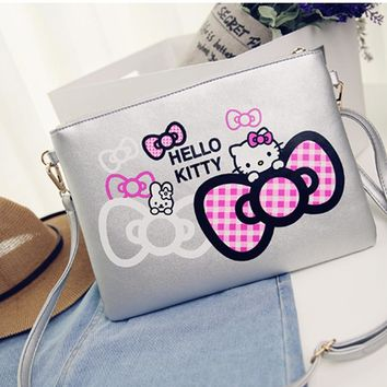 Hello kitty  clutch purse / crossbody bag with adjustable shoulder strap that is detachable