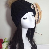 Moncler raccoon knitted wool hat