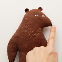 A strange serious woodland creature - brown bear critter - forest animal toy for children