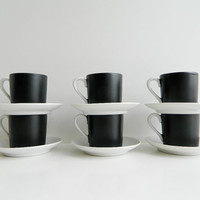 Black and white espresso or demitasse cups and saucers