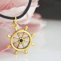 Cute necklace. Gold Wheel hanging on a Suede Cord. Beautiful sunny pendant.