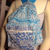 Blue backpack with lace overlay