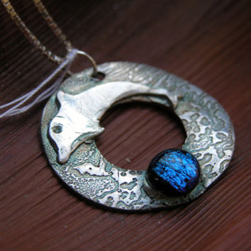 fine silver dolphin with blue dichroic glass