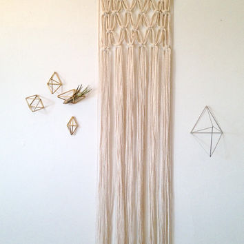 Macrame wall hanging, cotton on a walnut stained wood dowel. Chunky geometric square shape.