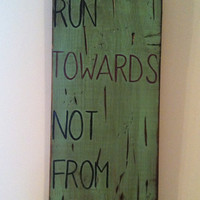 "Custom quote ""Run Towards Not From"" sign"