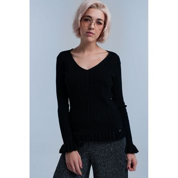 Black knitted ruffled sweater
