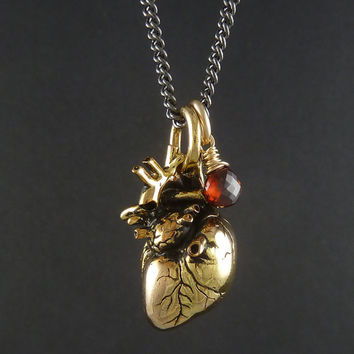 "Anatomical Heart Necklace 24 Karat Gold Plated Heart Pendant with 14 Karat Gold Filled Wire Wrapped Garnet On 24"" Gunmetal Chain"