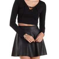 Black Lace-Up Caged Long Sleeve Crop Top by Charlotte Russe