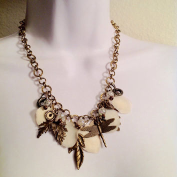 Statement necklace // dragonfly // shell charms // found object necklace // chunky necklace // bronze necklace