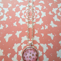 Wild child pink leopard print round glass dome necklace for fashionable kids, tween or teen girl