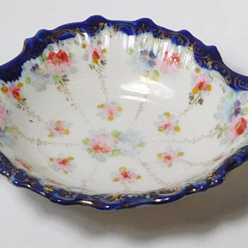 Victorian Style Soap Dish Bowl Trinket Tray Gold Trim Painted Muted Pink Purple Flower Design Scalloped Edges Dark Cobalt Blue Trim Vintage