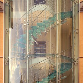 Glass and Stainless Steel Spiral staircase IMPERIALE Stairs Collection by FARAONE | design Mauricio Cárdenas Laverde