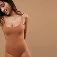 Nubian Skin Naked Collection Nude Bodysuit In Warm at asos.com