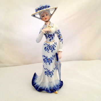 Victorian Lady Figurine made in Japan featuring Beautiful Blue and Shiny Gold on White Porcelain China - Touring Hat Parasol