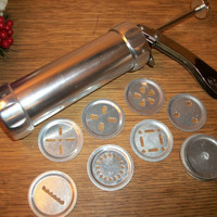 Biscuit Brand Stainless Steel Cookie Press Ratchet Precision 20 Disc Baking Tool from A Vintage Addiction