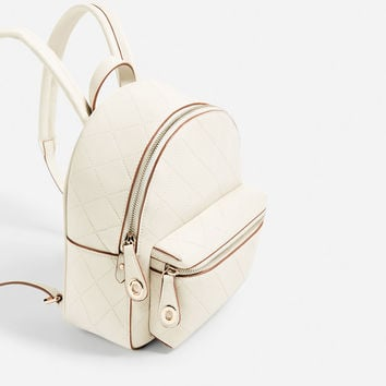 EMBOSSED POCKET BACKPACK