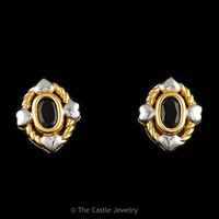 Bezel Set Oval Sapphire Earrings in Two Toned Rope and Heart Mounting in 14K Yellow and White Gold