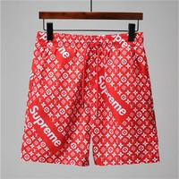 Red SUPREME LOUIS VUITTON Beach Shorts 001
