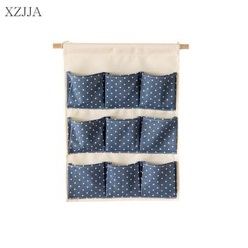XZJJA Cotton Linen Hanging Organizers Storage bag Useful Wardrobe Hang Bag Wall Pouch Cosmetic Toys Pockets stationery Organize
