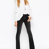 ASOS Baby Kick Flare Jeans In Washed Black With Lace-Up Fly at asos.com