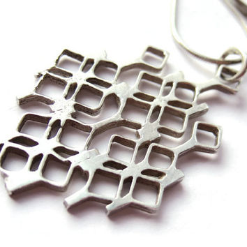 Vintage modernist sterling silver pendant, fully hallmarked Birmingham England 1978, maker AJH, openwork abstract design, snake chain. #202.