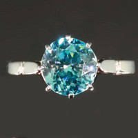 Antique jewelry French Art Deco platinum engagement ring with top starlite